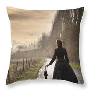 Victorian Woman Walking On A Cobbled Avenue At Sunset Throw Pillow