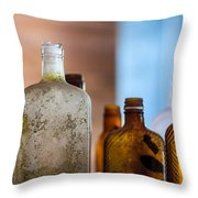 Vintage Bottles Throw Pillow by Adam Romanowicz