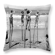 Volleyball On Stilts Throw Pillow by Underwood Archives