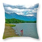 Wading In Johnson Lake In Banff Np-alberta Throw Pillow