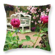 White Bench And Pink Climbing Roses In English Garden Throw Pillow