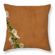 White Hollyhock Against Orange Wall Throw Pillow