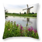Windmills Of Kinderdijk With Wildflowers Throw Pillow by Carol Groenen