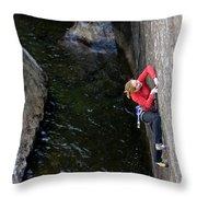 Woman Climbing Above A River Throw Pillow