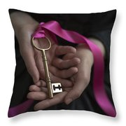 Woman Holding A Golden Key On A Pink Ribbon Throw Pillow