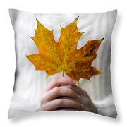 Woman Holding An Autumn Leaf Throw Pillow