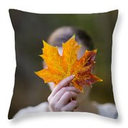 Woman Holding An Autumnal Leaf Throw Pillow