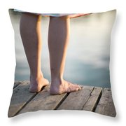 Woman In A Dress On The Edge Of A Wooden Board Walk Throw Pillow