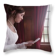 Woman In A Regency Dress Reading A Letter Throw Pillow