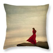 Woman In A Vintage Red Dress On A Windy Clifftop Throw Pillow