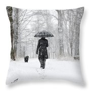 Woman Walking In A Snowy Forest Throw Pillow