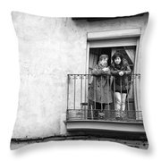 Women In Balcony Throw Pillow