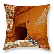 Women Leaving A Storage Place Near The Treasury In Petra-jordan Throw Pillow