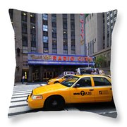 Yellow Cabs Pass In Front Of Radio City Music Hall Throw Pillow by Amy Cicconi