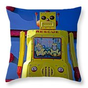 Yellow Robot In Front Of Drawers Throw Pillow by Garry Gay