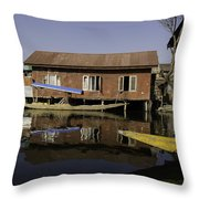 Yellow Shikara In Front Of A Run Down Area Of Houses In The Dal Lake Throw Pillow