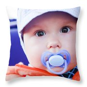 Young Baby Boy With A Dummy In His Mouth Outdoors Throw Pillow