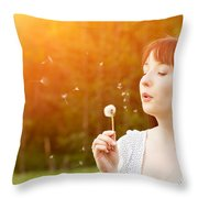 Young Beautiful Woman Blowing A Dandelion In Spring Scenery Throw Pillow