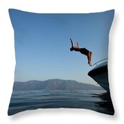 Young Man Flips Off A Boat At Sunset Throw Pillow
