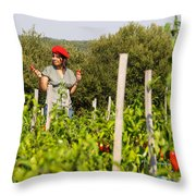 Young Woman Harvesting Red Peppers Throw Pillow