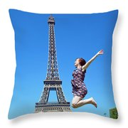 Young Woman Jumping Against Eiffel Tower Throw Pillow