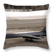 A B-1b Lancer Performs A Touch And Go Throw Pillow