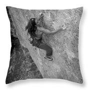 A Caucasian Women Rock Climbing Throw Pillow