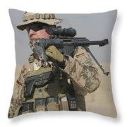 A German Soldier Carries A Barrett Throw Pillow