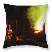 A Man In Protective Gear Tends Throw Pillow
