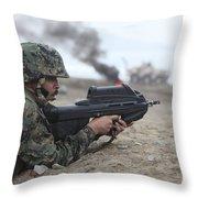 A Peruvian Marine Assaults A Beach Throw Pillow