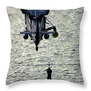 A Search And Rescue Swimmer Is Hoisted Throw Pillow