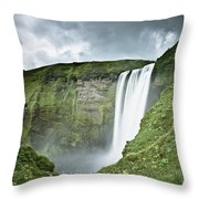 A Waterfall Over A Grassy Cliff Throw Pillow