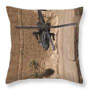 An Ah-64d Apache Helicopter In Flight Throw Pillow