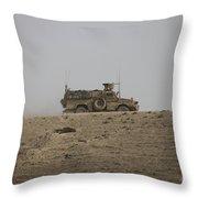 An Mrap Vehicle Patrols The Ridge Throw Pillow