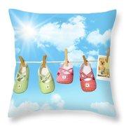 Baby Shoes And Teddy Bear On Clothline Throw Pillow by Sandra Cunningham