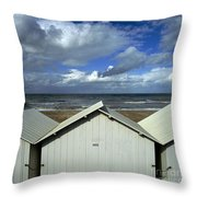 Beach Huts Under A Stormy Sky In Normandy Throw Pillow