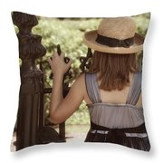Girl Looking Over Iron Gate Throw Pillow