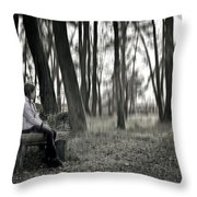 Girl Sitting On A Wooden Bench In The Forest Against The Light Throw Pillow by Joana Kruse