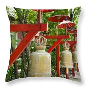 Row Of Bells In A Temple Covered By Red Umbrella Throw Pillow