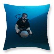 Scuba Diver Uses A Diver Propulsion Throw Pillow