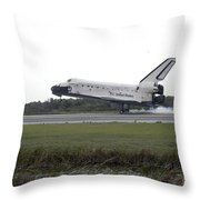 Space Shuttle Discovery Touches Throw Pillow