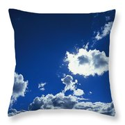 Sunlit Fluffy White Clouds In A Blue Throw Pillow