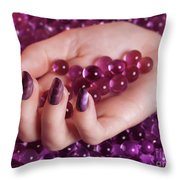 Woman Hand With Purple Nail Polish On Candy Throw Pillow