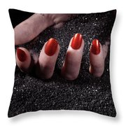 Woman Hand With Red Nails On Black Sand Throw Pillow