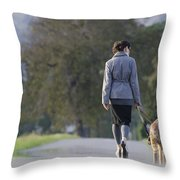 Woman Walking With Her Dogs Throw Pillow
