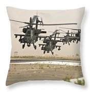 A Group Of Ah-64d Apache Helicopters Throw Pillow