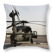 A Uh-60 Black Hawk Helicopter Parked Throw Pillow