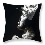 An Astronaut Anchored To A Mobile Foot Throw Pillow