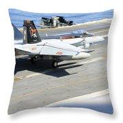 An Fa-18e Super Hornet Lands Aboard Throw Pillow