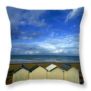 Beach Huts Under A Stormy Sky In Normandy Throw Pillow by Bernard Jaubert